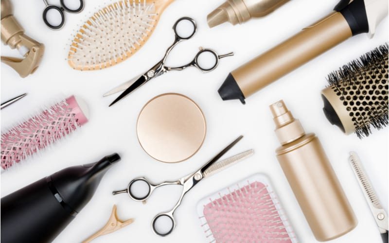 For a piece on Walmart Hair Salon services and pricing Hairdressing tools and various hairbrushes on white background top view