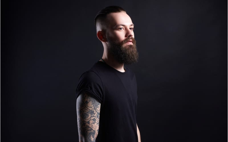 Boy with stylish undercut and tattoo. handsome Man, Tattoed bearded hipster