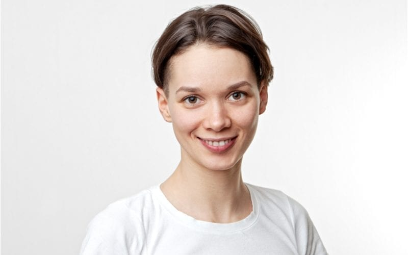 Woman with a two block haircut looking at the camera