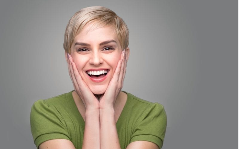 Cute laughing shocked surprised perfect smile white teeth happy with dental visit