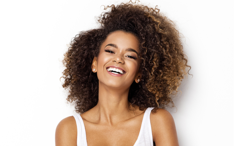 Beautiful african american girl with a curly haircut smiling