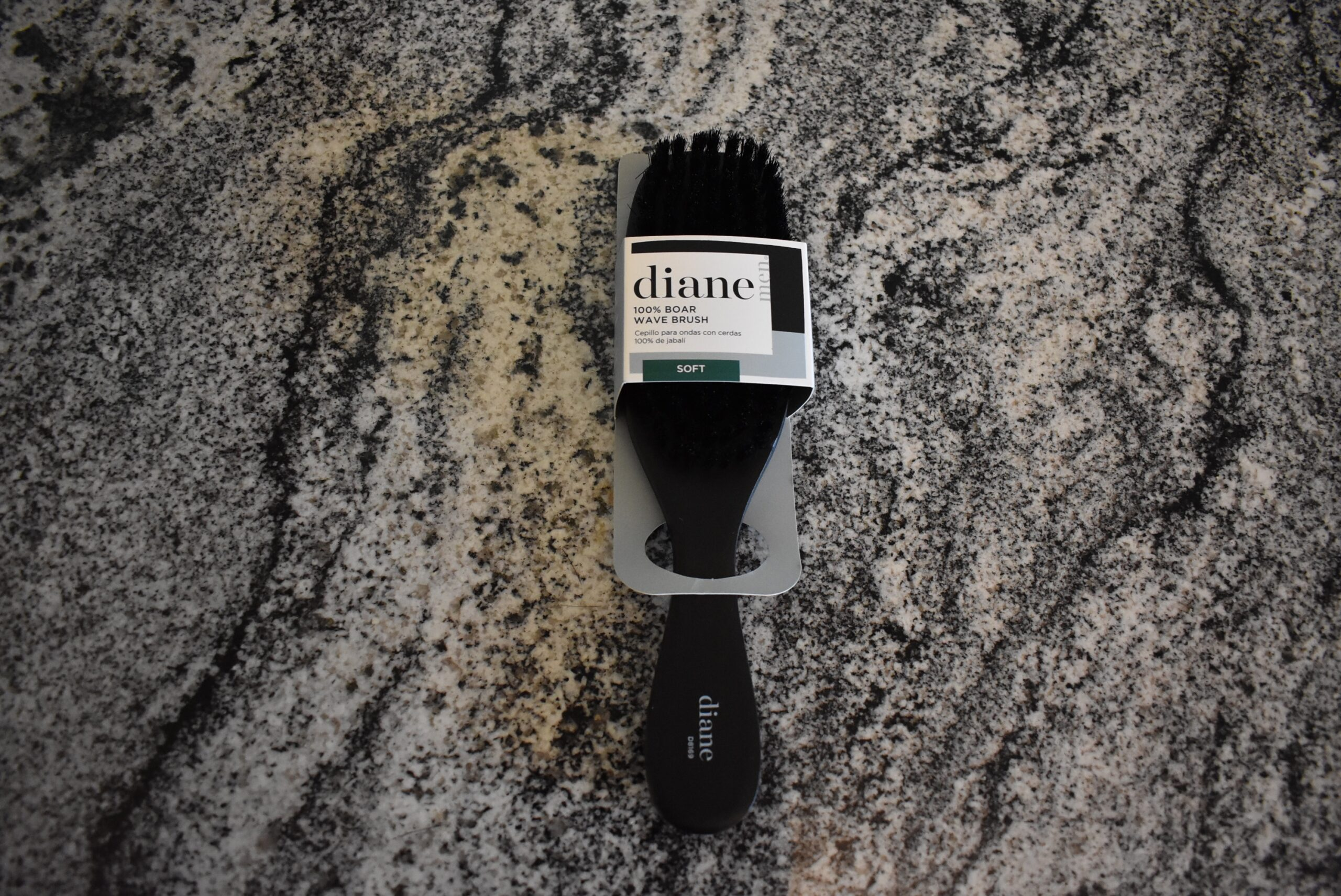 The diane boar brush (one of the best hair brushes) sitting on a counter before being unwrapped for a review