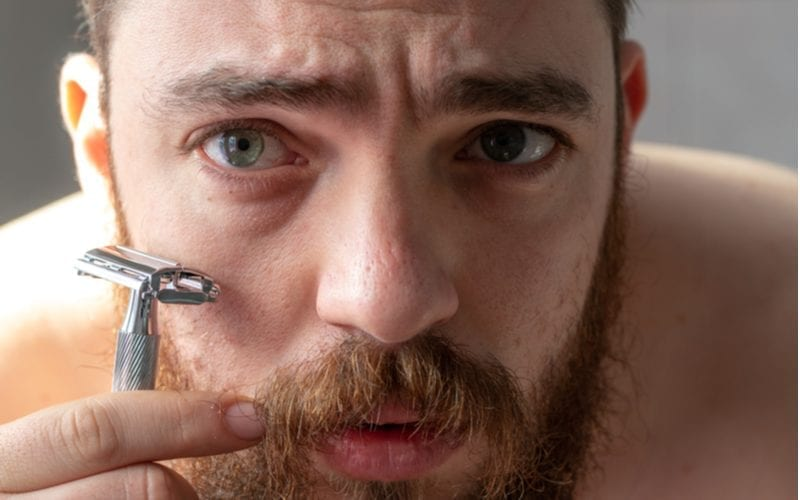 Man holding the best safety razor against his face