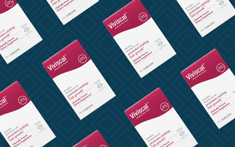 Viviscal products laid out at an angle for a piece on Nutrafol vs Viviscal