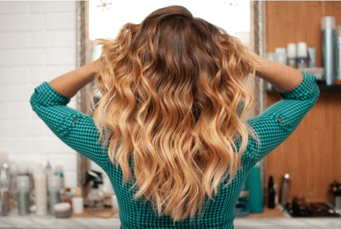 Lady with Ombre hair for a piece on what is Ombre holding her locks up so they don't touch her shoulders