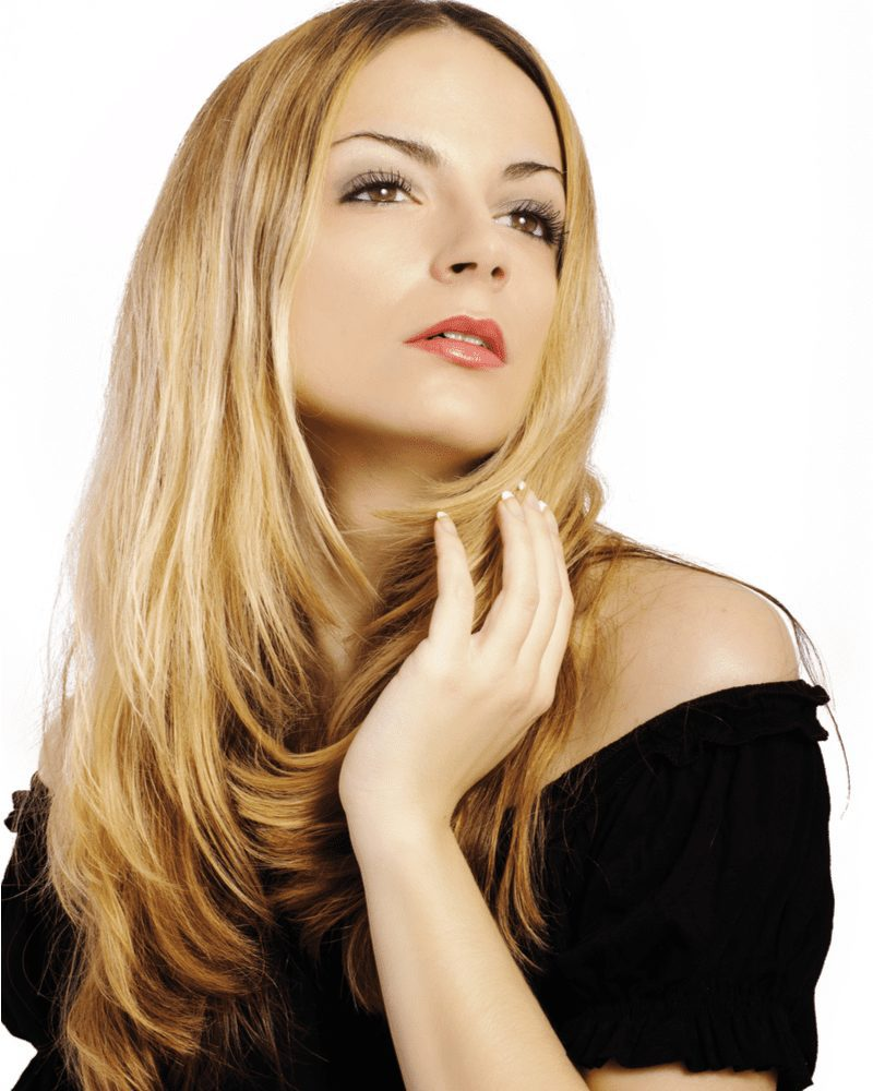 Blonde woman with a Double Layered Cut holding her cheek