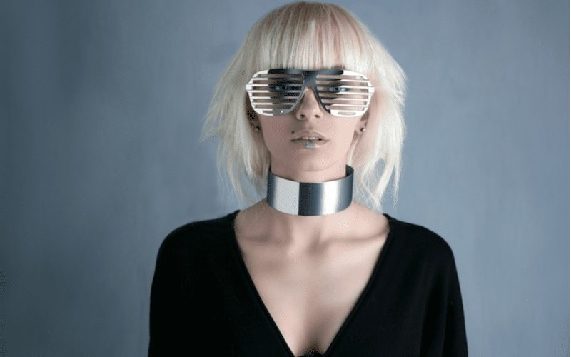 Blunt Bang Wolf Cut on a fashionable woman in silver glasses