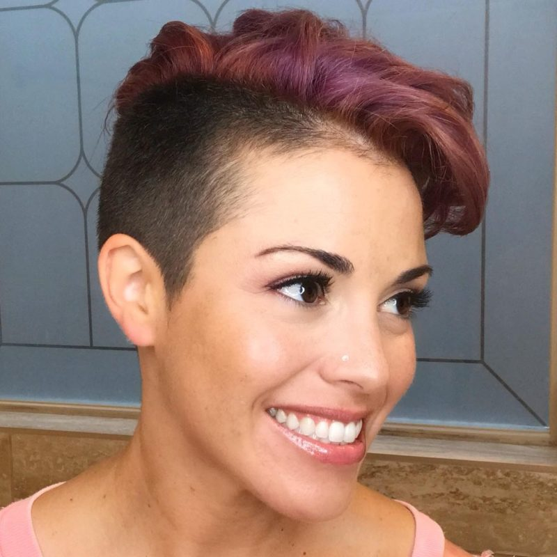 Two tone mohawk for females on a smiling woman with a partial fade
