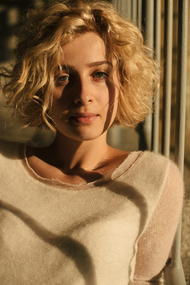 Boho Air-Dried Curly Bob on a woman in a sweater with droopy eyes